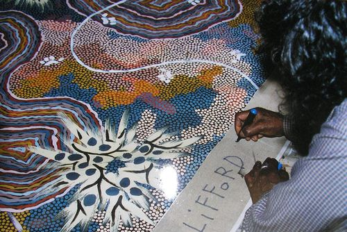 1994 Posum Dreaming at Nappery being signed by Clifford Possum