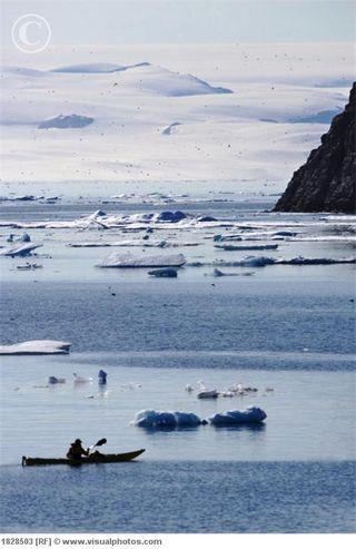 Kayak_ice_berg_off_coast_of_nunavut_canada_1828503