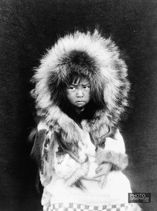 Noatak-child-three-quarter-length-portrait-seated-facing-front.-Noatak-Alaska.-1929.-Photo-Edward-S.-Curtis